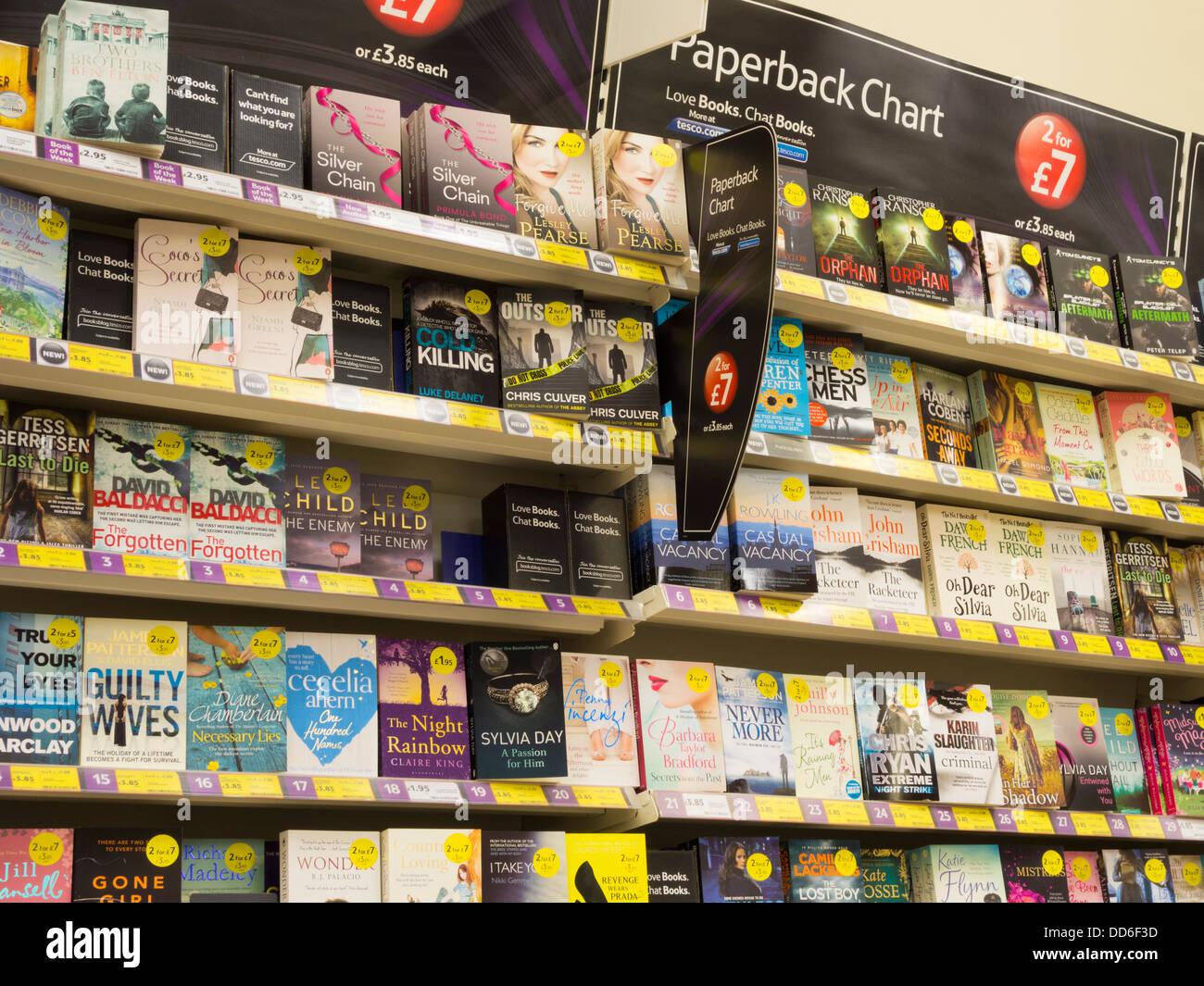 Paperback books in Tesco supermarket. UK - Stock Image