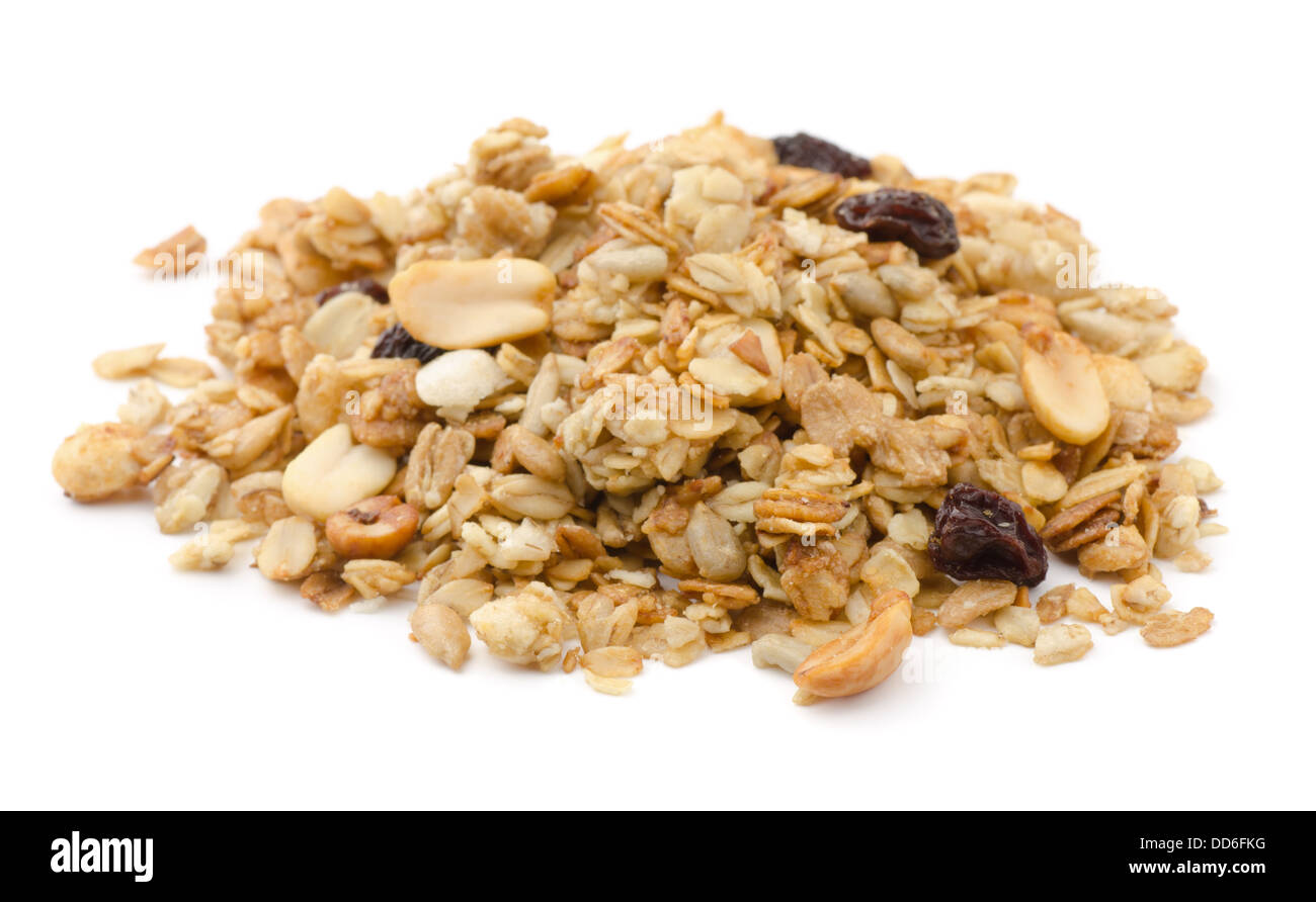 Pile of granola cereal with raisins and nuts isolated on white - Stock Image