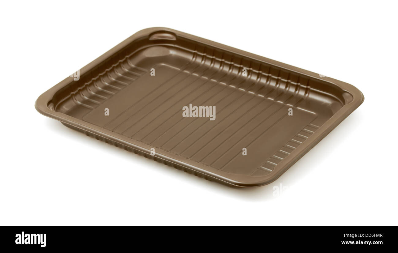 Empty brown plastic packaging food tray isolated on white - Stock Image