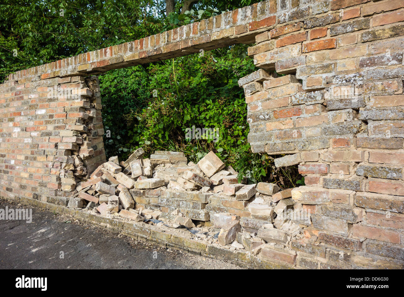 Hole in brick wall caused by car crash, Landbeach, Cambridgeshire - Stock Image