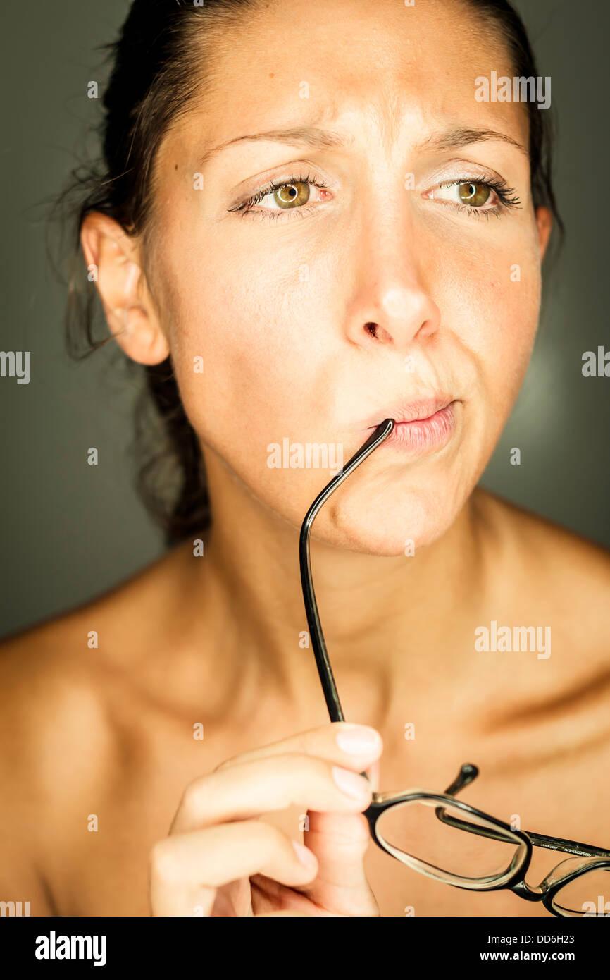 Studio, Junge Frau mit Brille Stock Photo