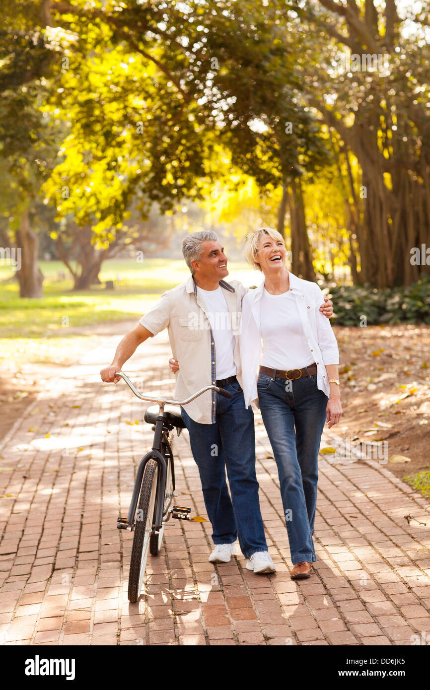beautiful mid age couple walking outdoors - Stock Image