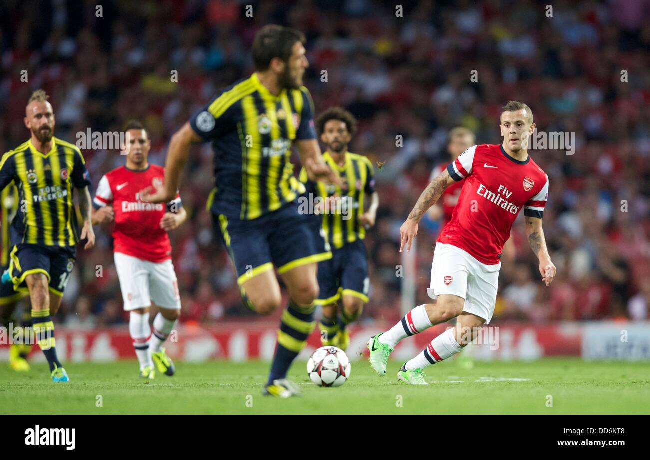 London, UK. 27th Aug, 2013. Jack Wilshere of Arsenal looks to split the defence with a pass during the Champions - Stock Image