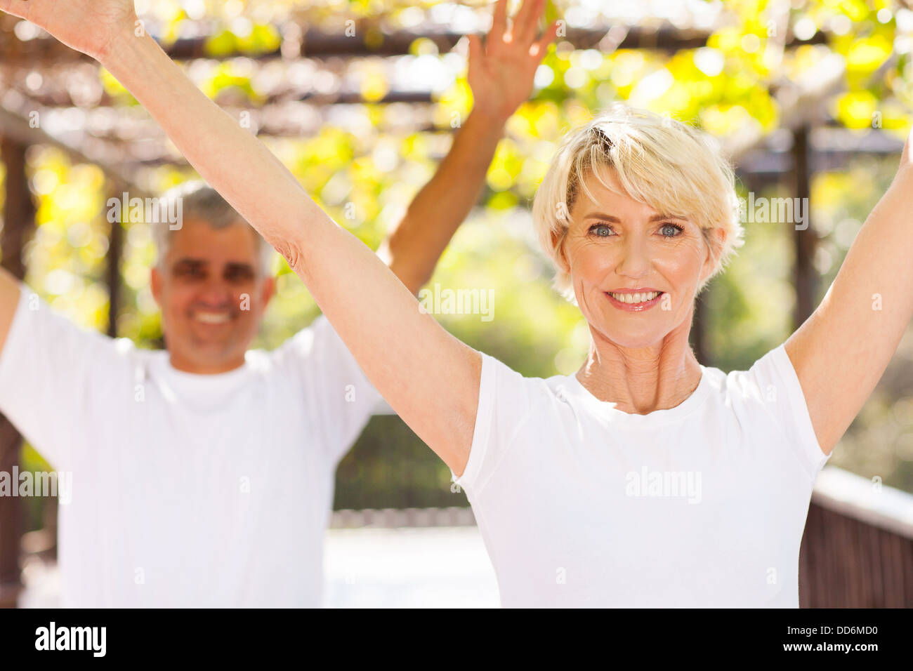 healthy senior couple working out outdoors - Stock Image