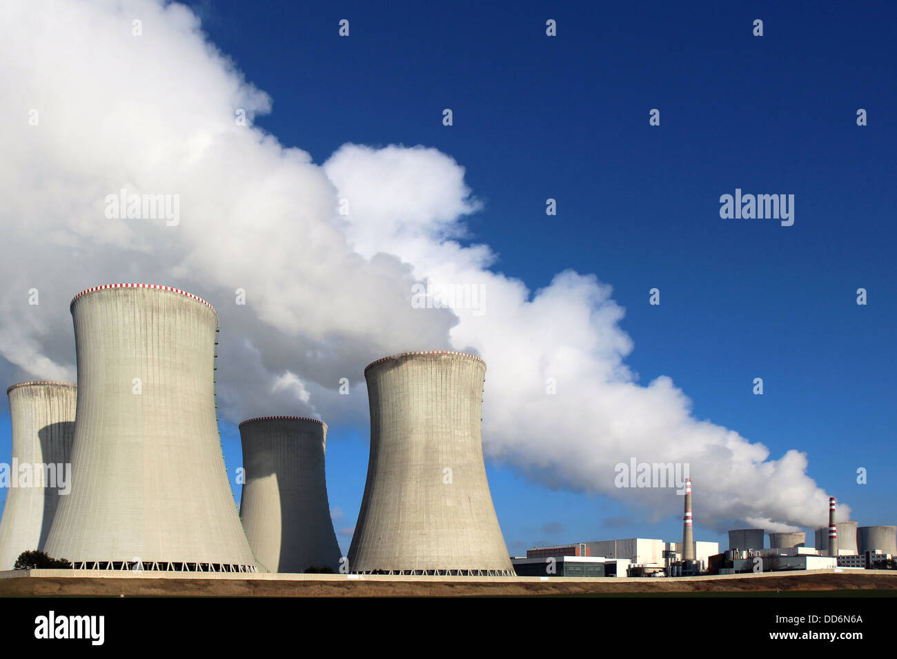 atomic power plant and huge smoke from cooling towers - Stock Image