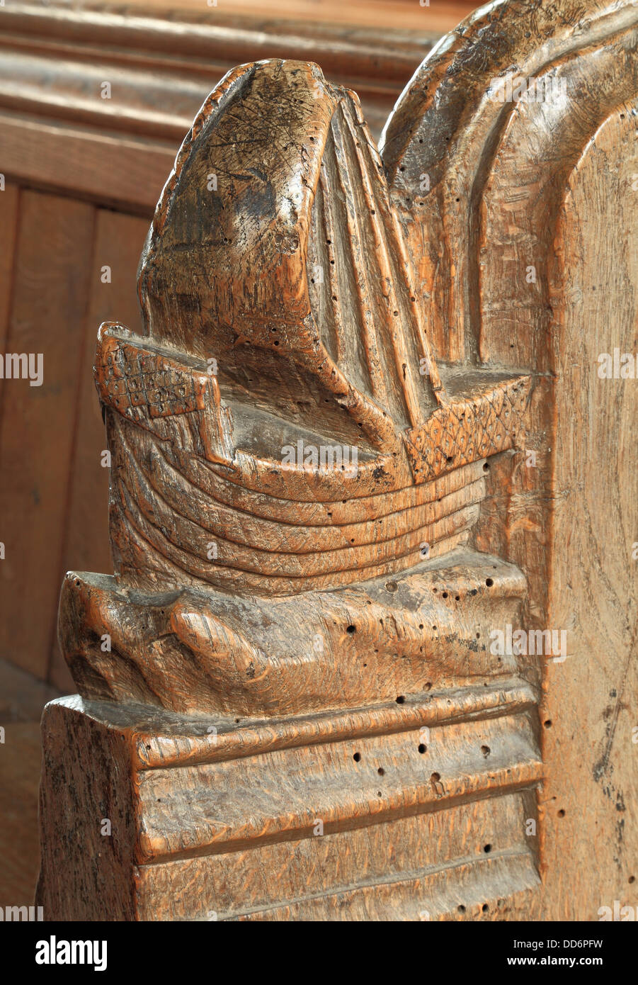 Medieval bench end, sailing ship, Thornham, Norfolk, 15th century wood carving, England UK, wood carving benchends - Stock Image