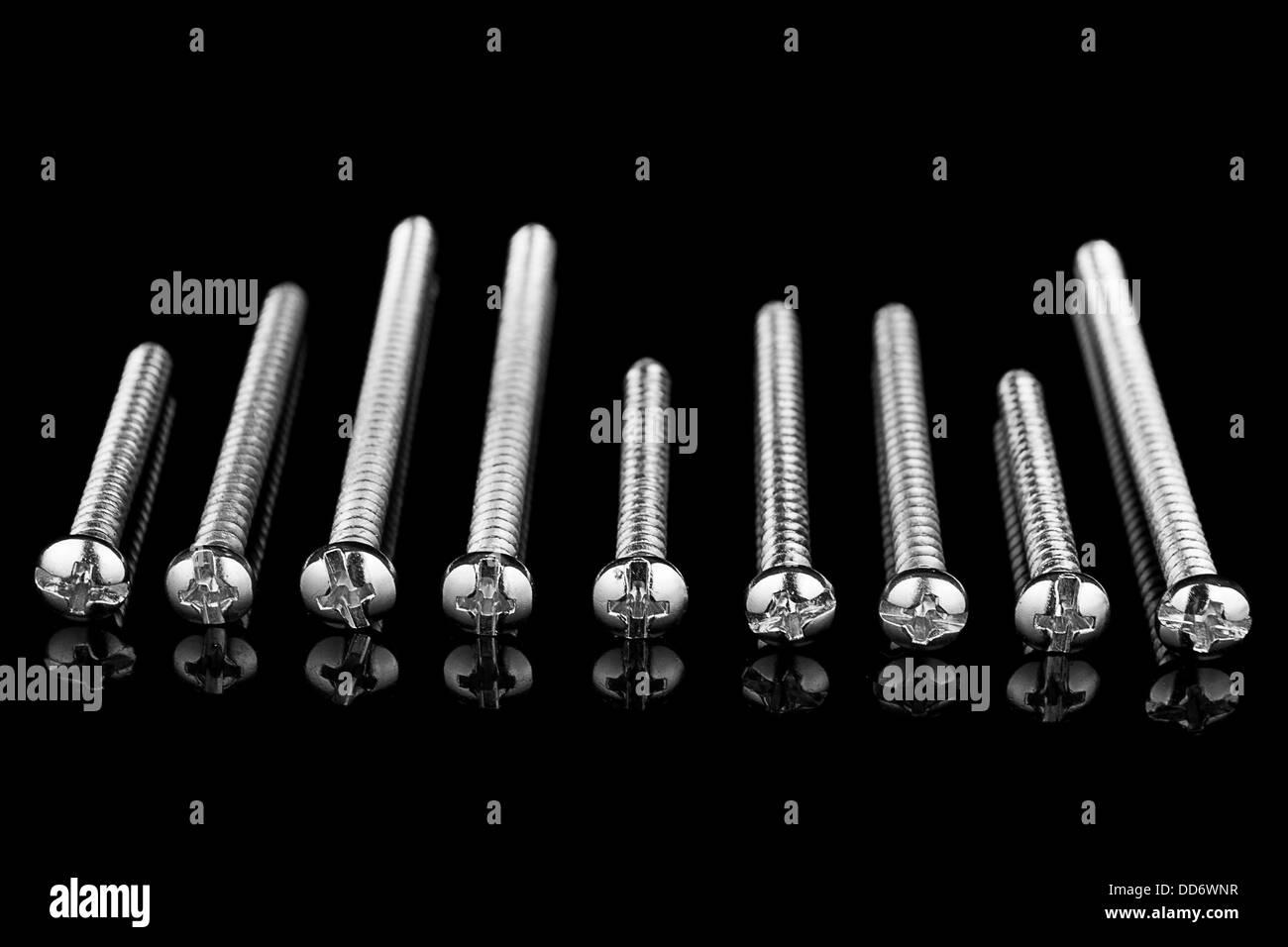 Screws on Black background - Stock Image