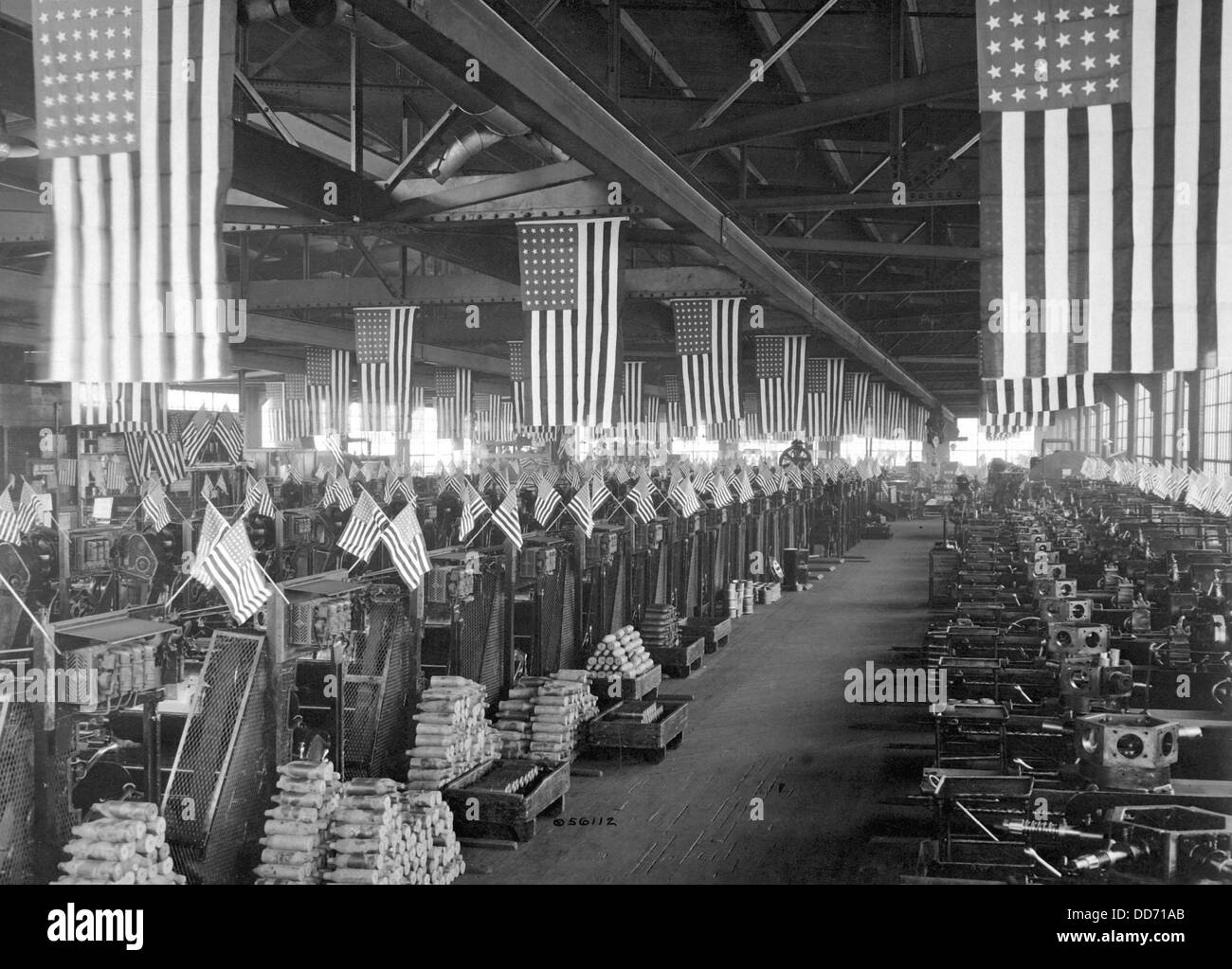 American flags decorate the machine shop for 3 inch artillery shells at the Bethlehem Steel Company during World Stock Photo