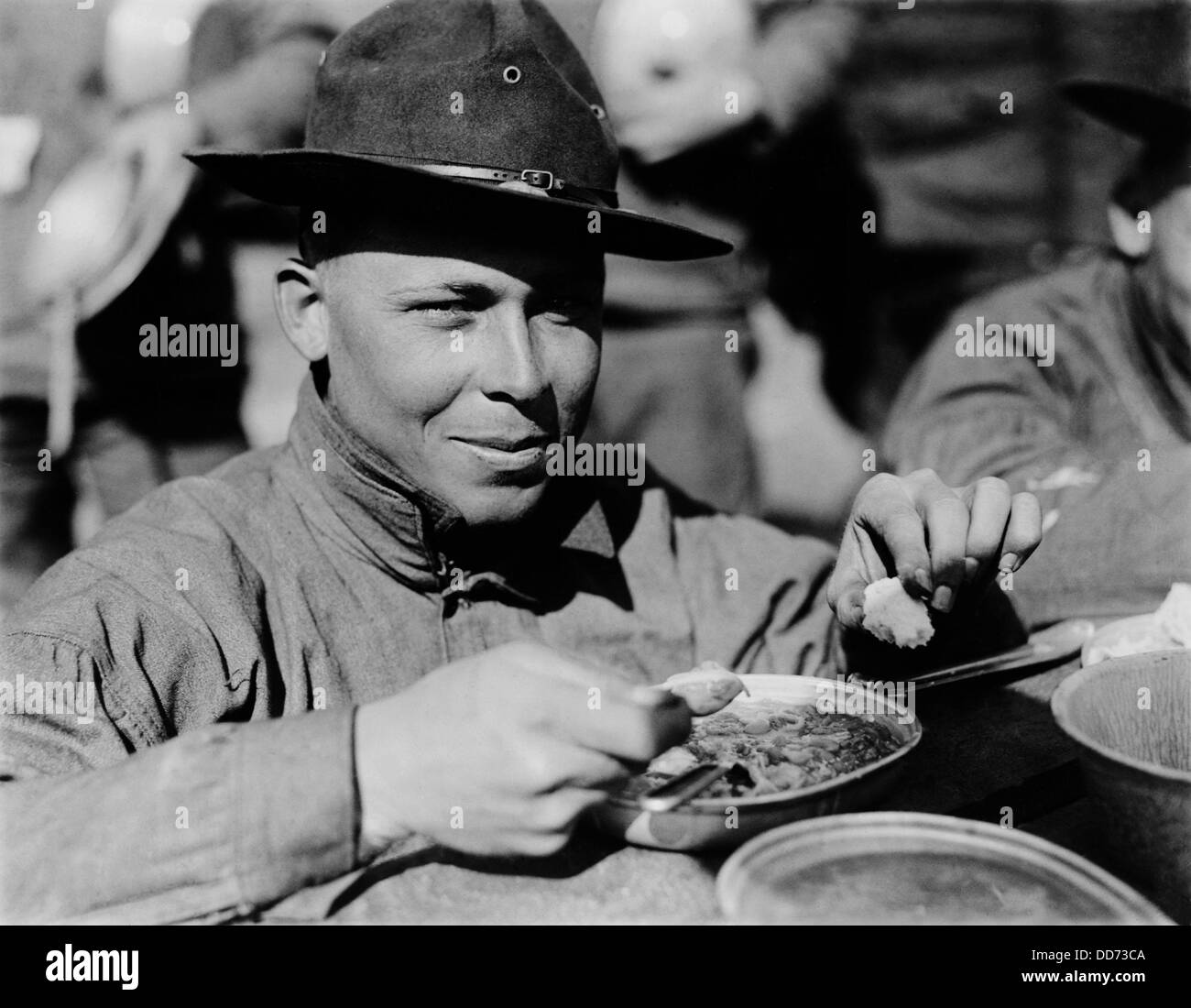 American WW1 soldier eating from his mess kit. 1917-18. (BSLOC_2012_4_159) - Stock Image