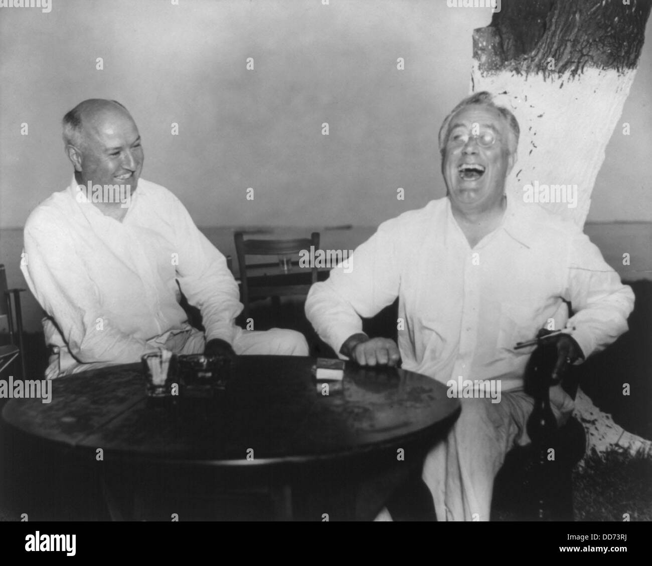 Franklin Roosevelt, laughing, with James Farley, at Jefferson Island, La. 1930s. Farley simultaneously served as - Stock Image