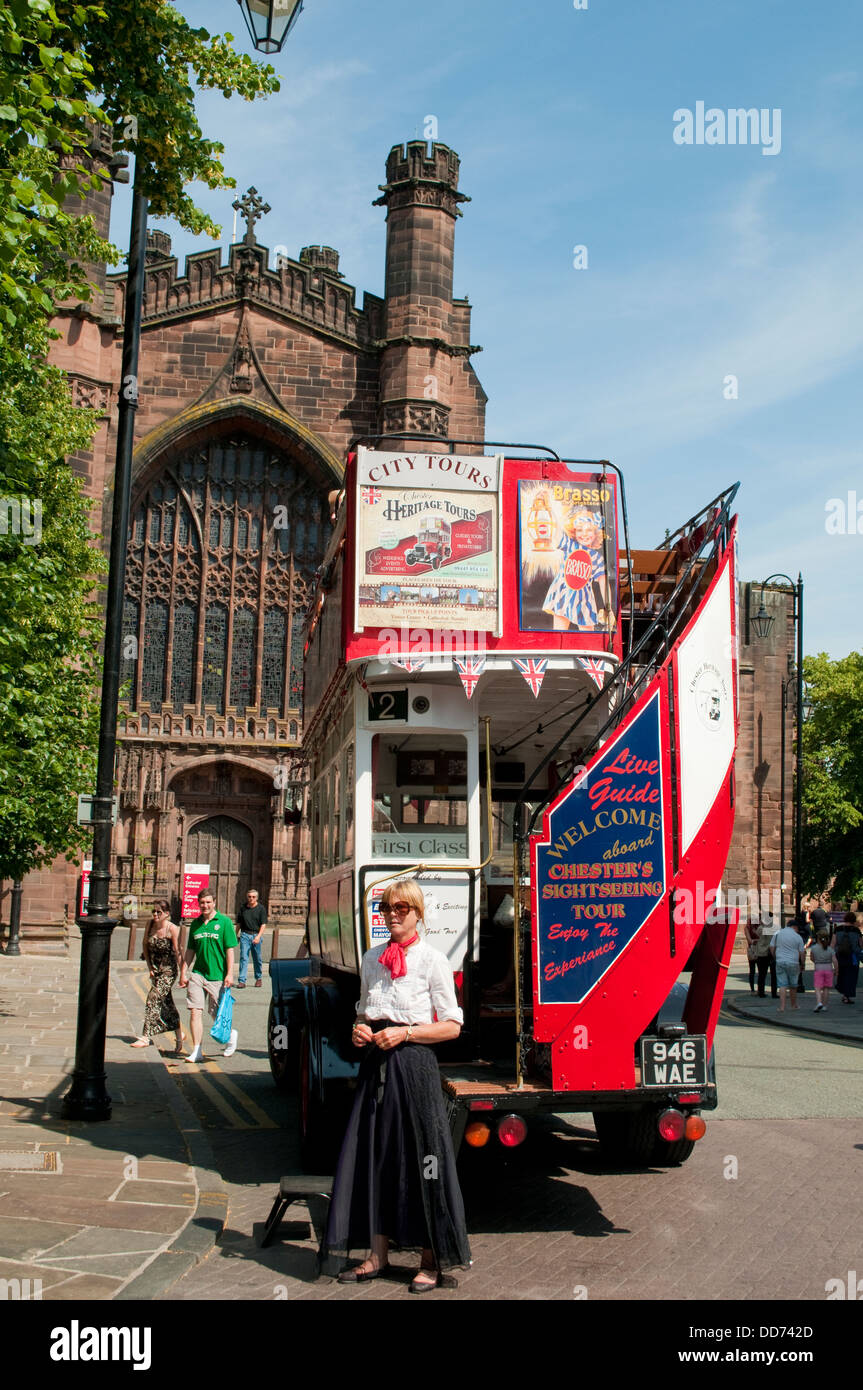 Tourist city tours bus in front of the Cathedral, Chester, UK - Stock Image