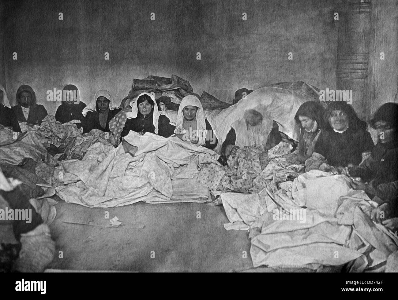 Armenian women sewing covers for blankets. Yerevan. Ca. 1915-1922. Thousands of survivors of the Armenian Genocide Stock Photo