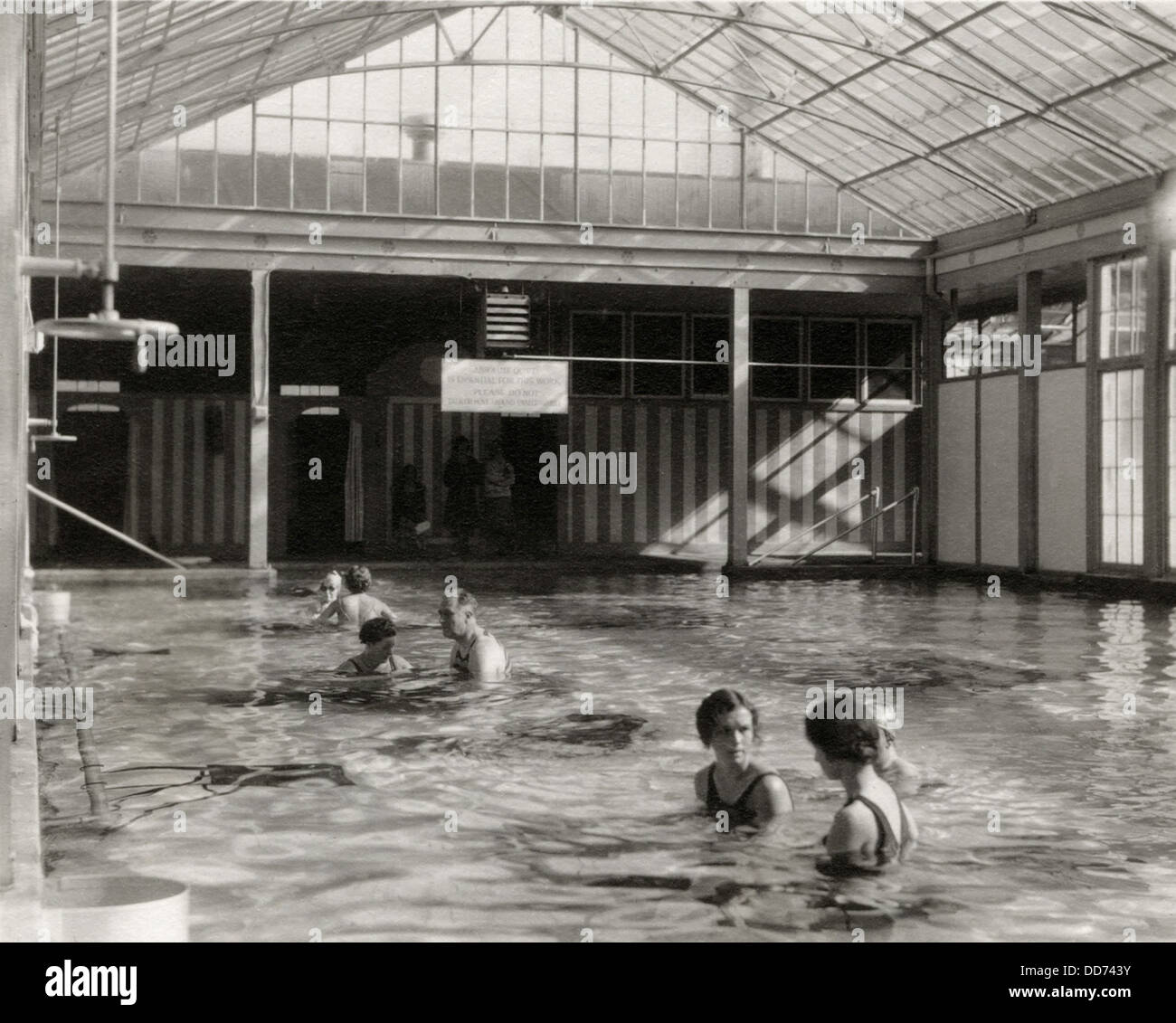 Franklin Roosevelt in physical therapy at Warm Springs indoor pool. 1928. The mineral springs flowed at nearly 32 - Stock Image