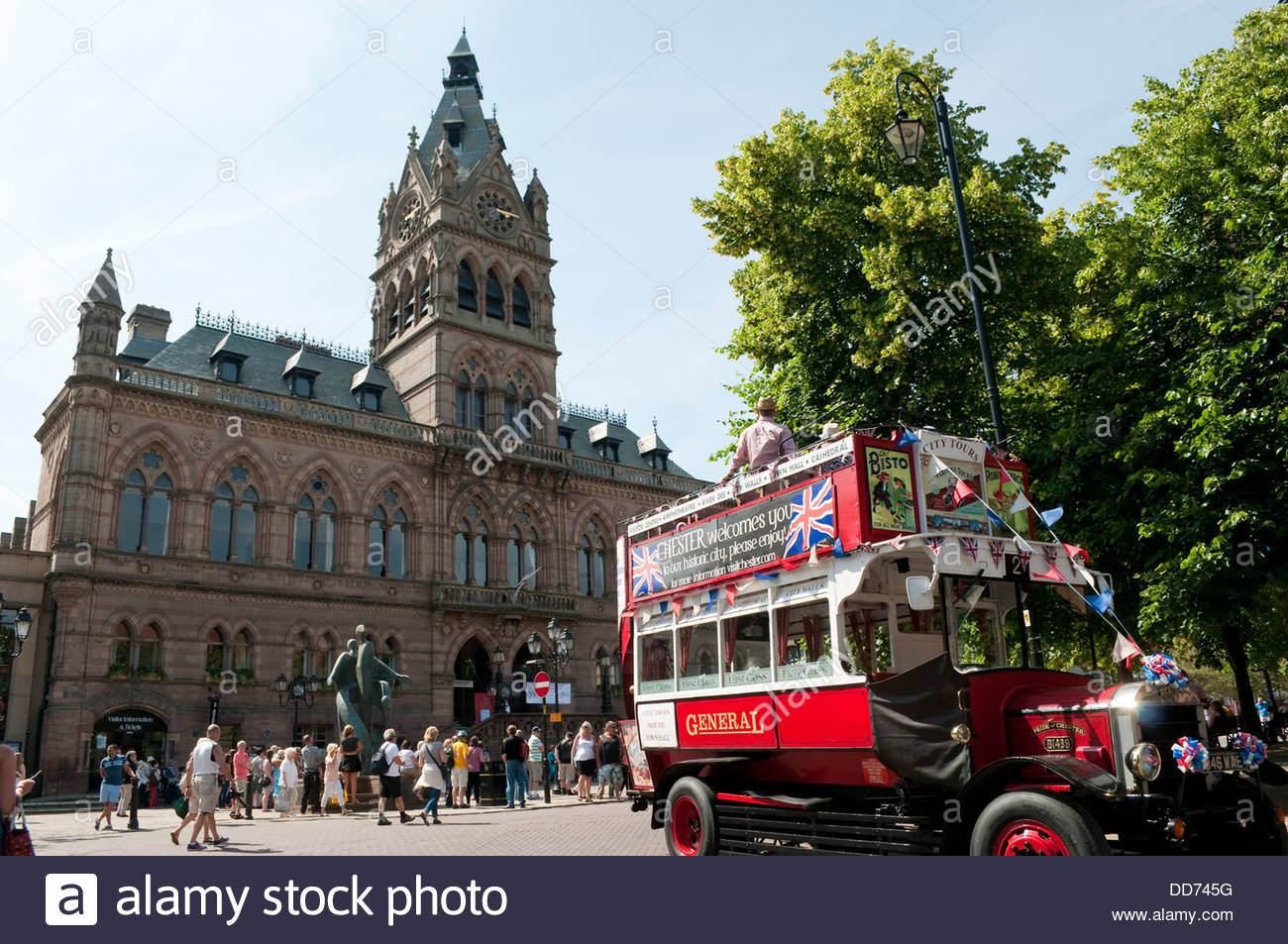 Tourist city tours bus and Town Hall, Chester, UK - Stock Image