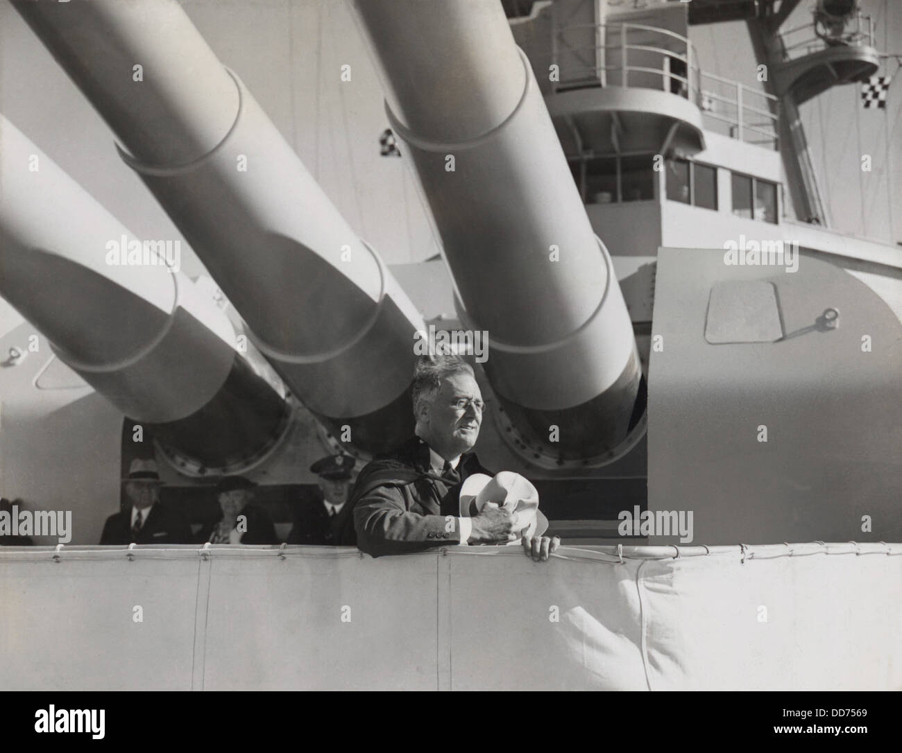 President Franklin Roosevelt under the big guns of the USS Houston. 1938. Roosevelt was reviewing the fleet in San - Stock Image