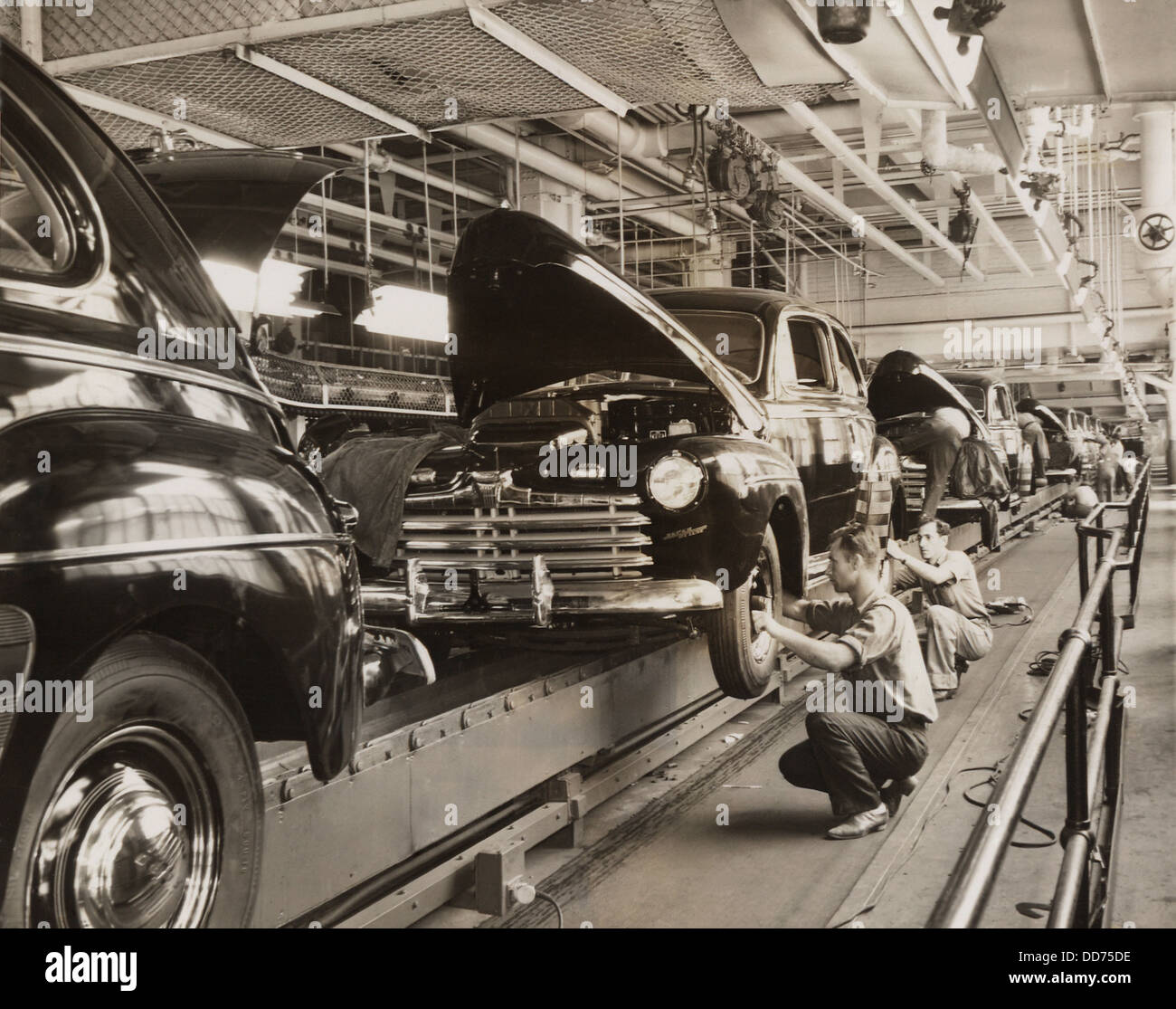 Ford Motor Company assembly line in the 1930s. (BSLOC_2013_7_104) - Stock Image