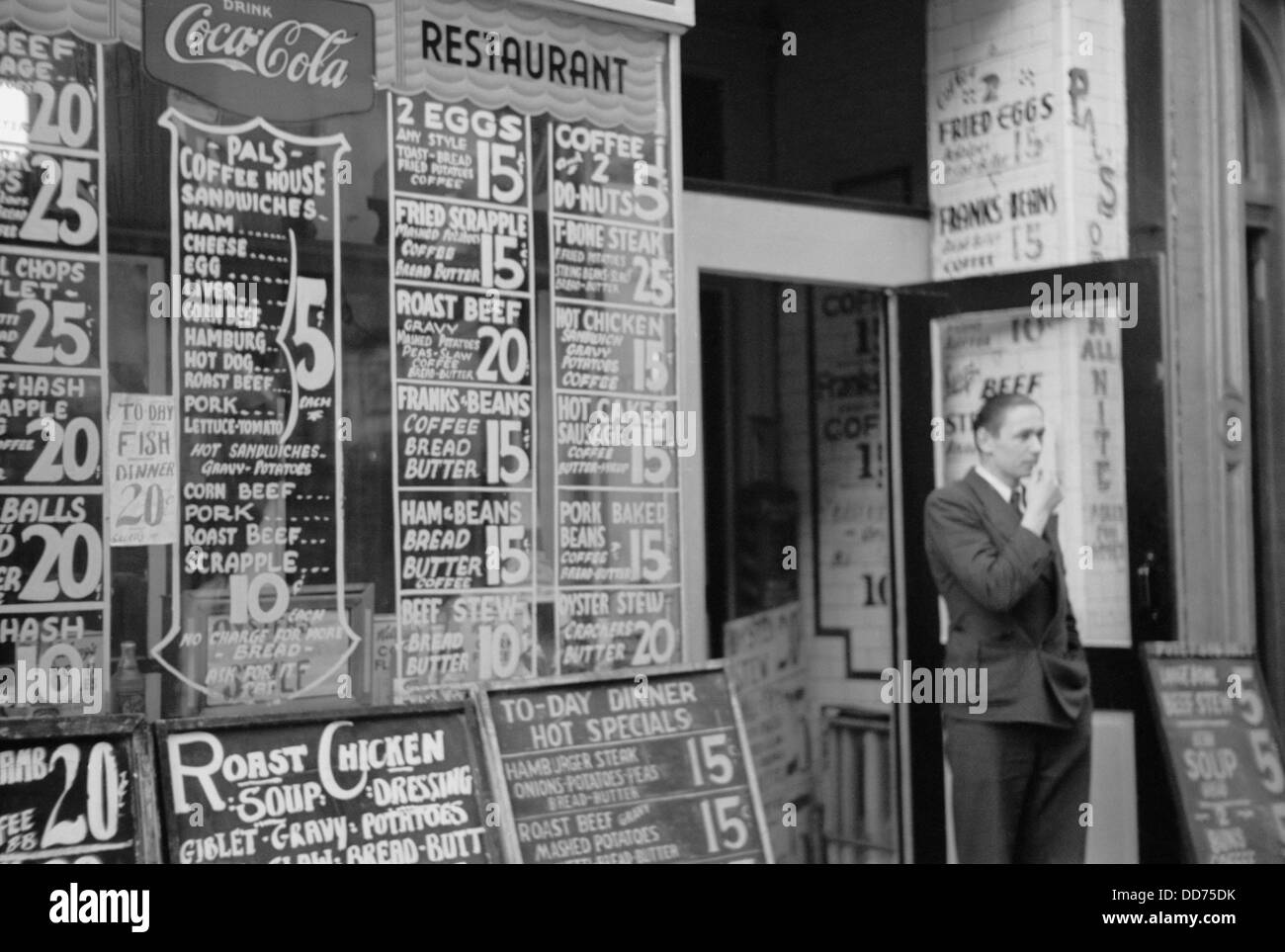 Depression era city restaurant with posted menu and prices