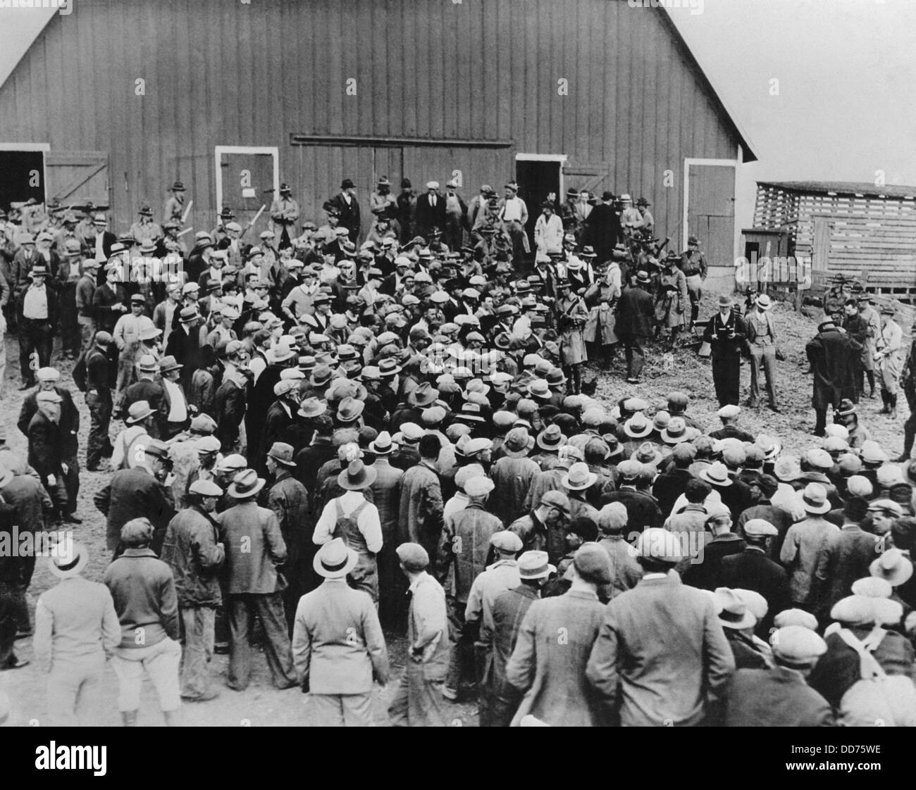 Military police at a farm foreclosure sale in Iowa in the early 1930s. Police were on hand to keep farmers from - Stock Image