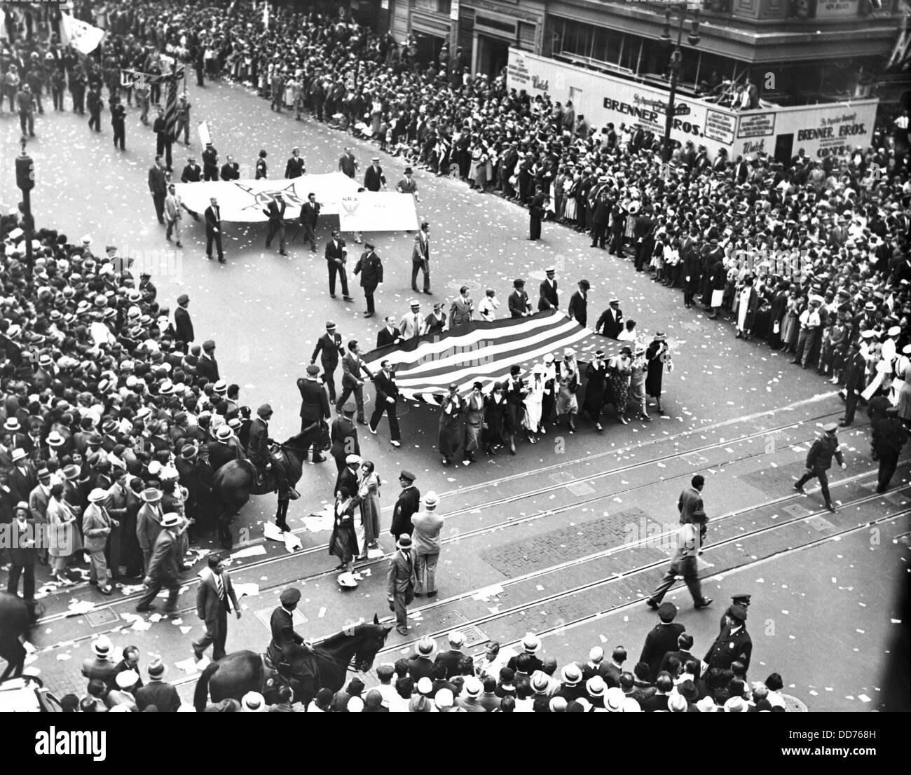 National Recovery Administration (NRA) parade, NYC, 1933. The large American flag is carried by female film industry - Stock Image