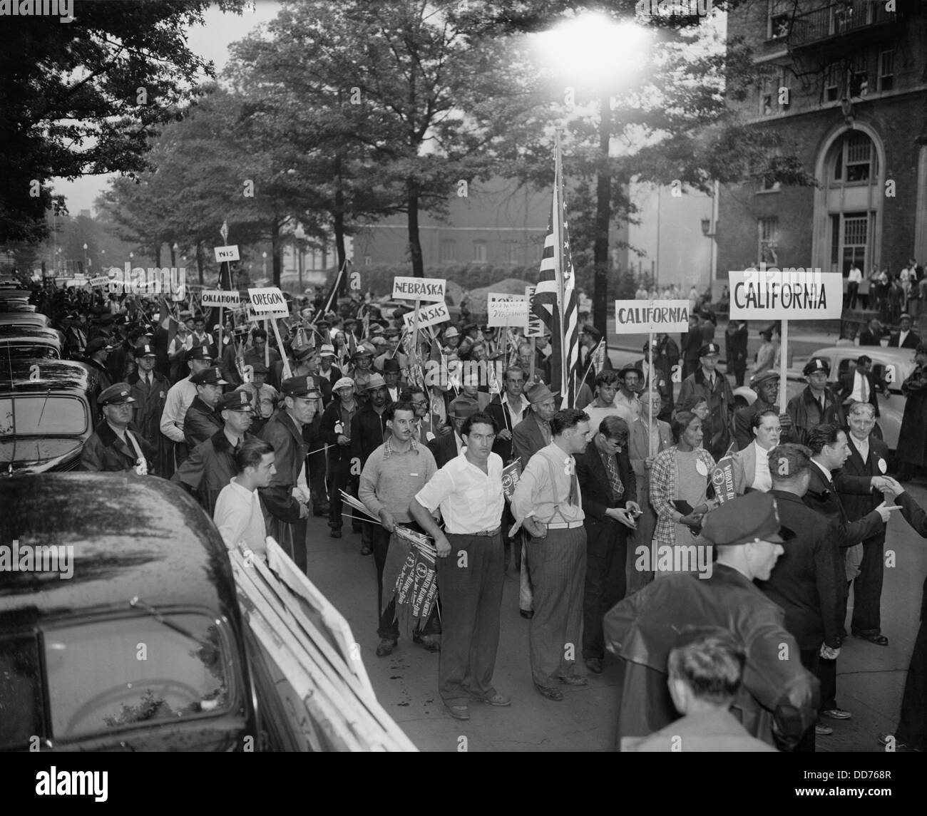 WPA workers protest lay-offs in Washington, D.C. Aug. 24, 1937. Some of the over 2000 dismissed WPA workers marching - Stock Image
