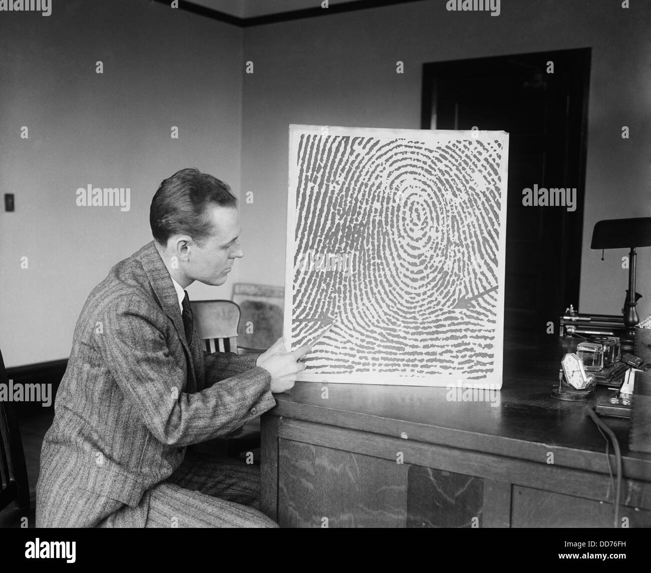 Demonstration of a fingerprint reconstructed from a verbal description received by telephone or telegraph, Jan. - Stock Image