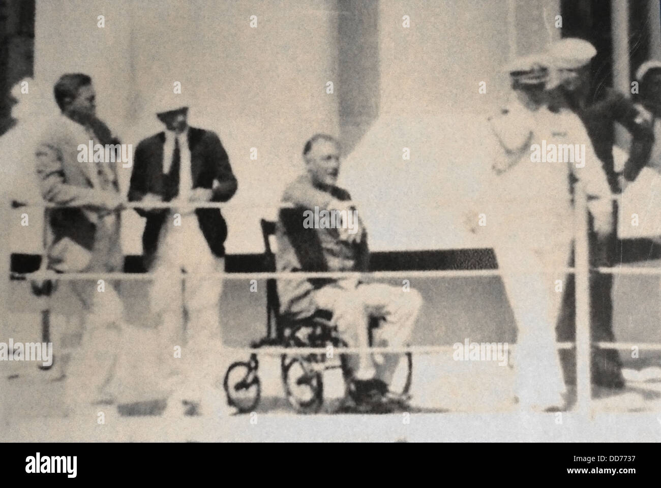 FDR in wheelchair aboard USS Indianapolis 1933 in photo by crewman Gerhard Stoeckel, Sr. On far left are Gus Gennerich Stock Photo