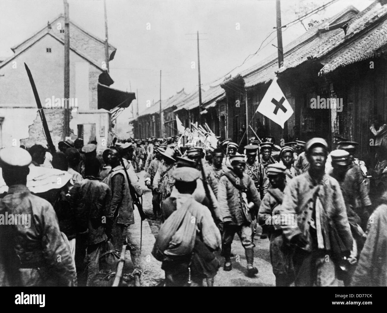 Retreating Chinese Nationalist soldiers entering the city of Tai-an. The Second Sino-Japanese War began in 1937 - Stock Image