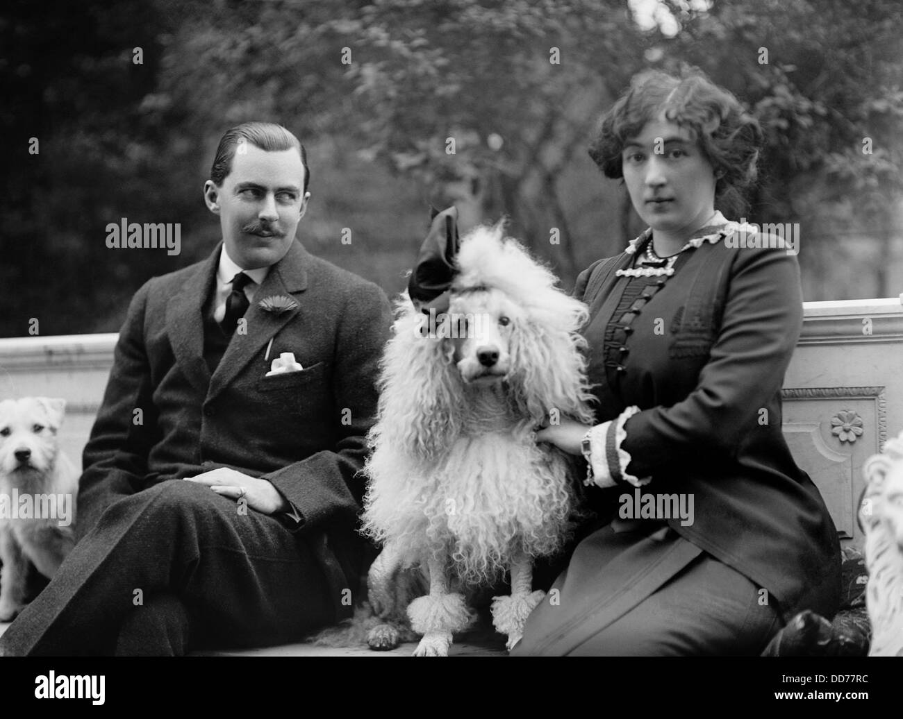 Edward Beale Mclean and his wife, Evalyn Walsh Mclean the their dogs in 1912. She was the only surviving child of - Stock Image