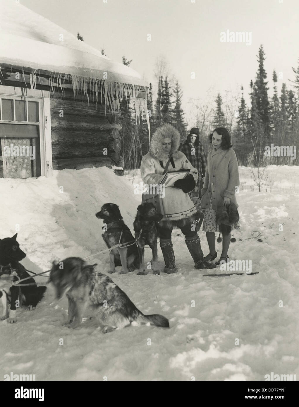 1940s Census taker in Fairbanks, Alaska. He traveled by dog sled to reach this woman's home. The dog musher - Stock Image