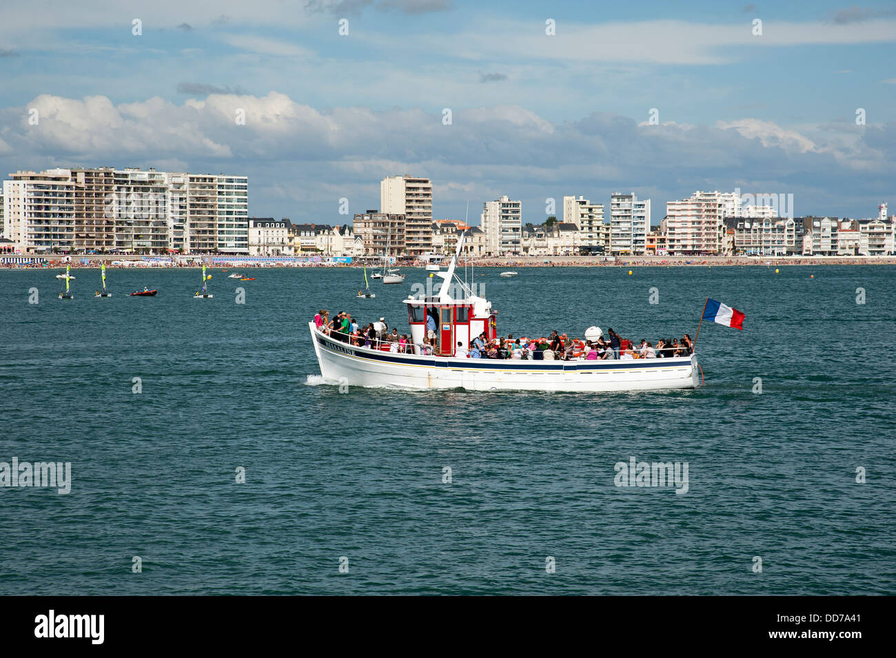 Pleasure boat off Les Sables D'Olonne seafront western France - Stock Image