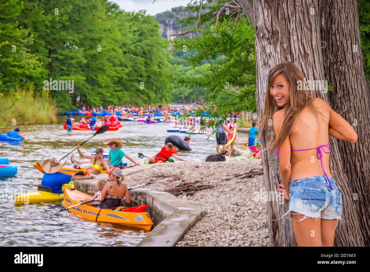 Usa Texas Young Woman In Bikini Standing Behind Tree