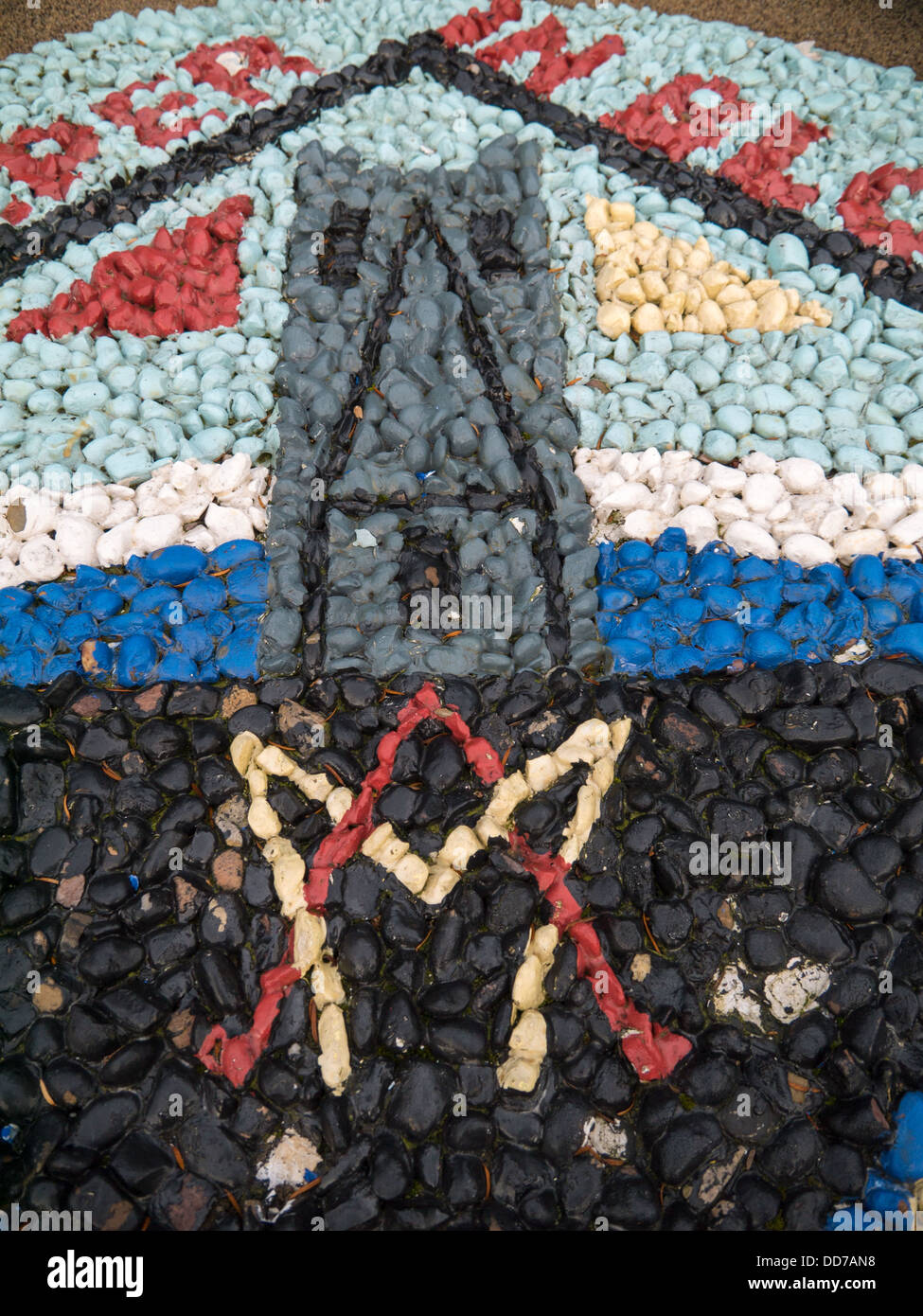 Mosaic of a Scouts badge at the Belper War Memorial Gardens - Stock Image
