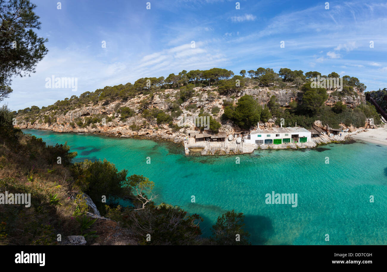 Spain, Majorca, View of house boat in bay of Cala Pi Llucmajor - Stock Image
