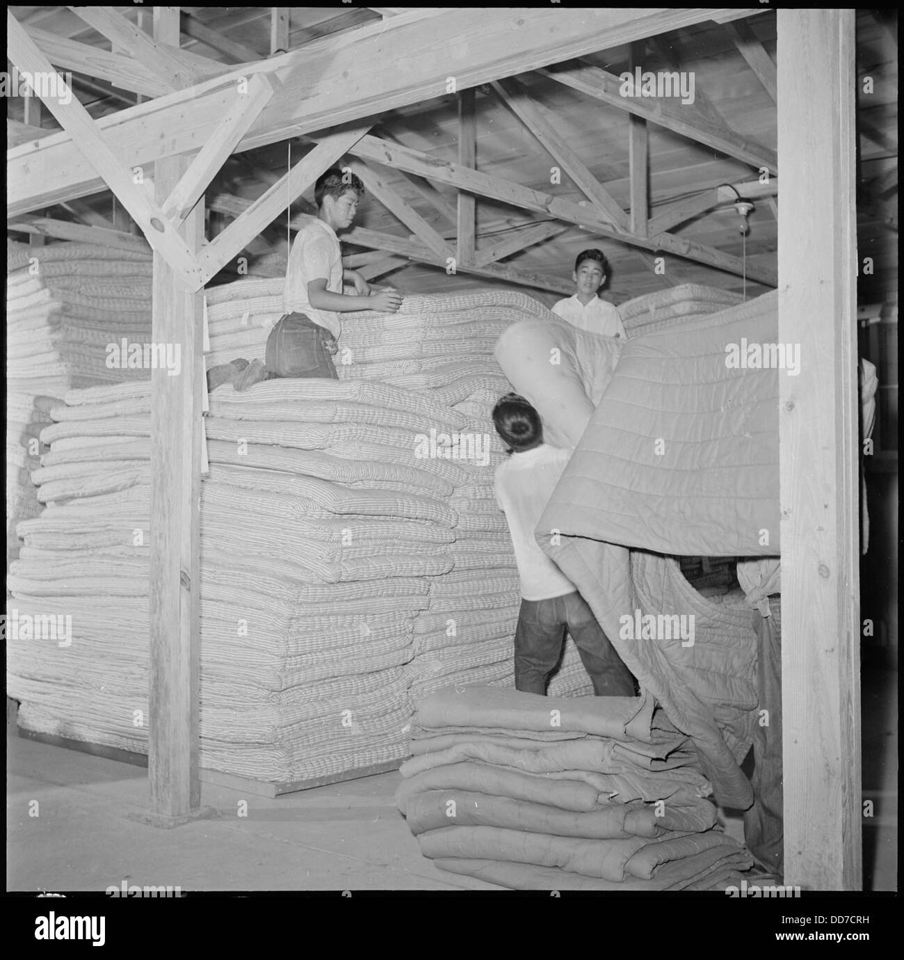 Closing of the Jerome Relocation Center, Denson, Arkansas. Storing mattresses in one of the Jerome . . . - - 539772 - Stock Image
