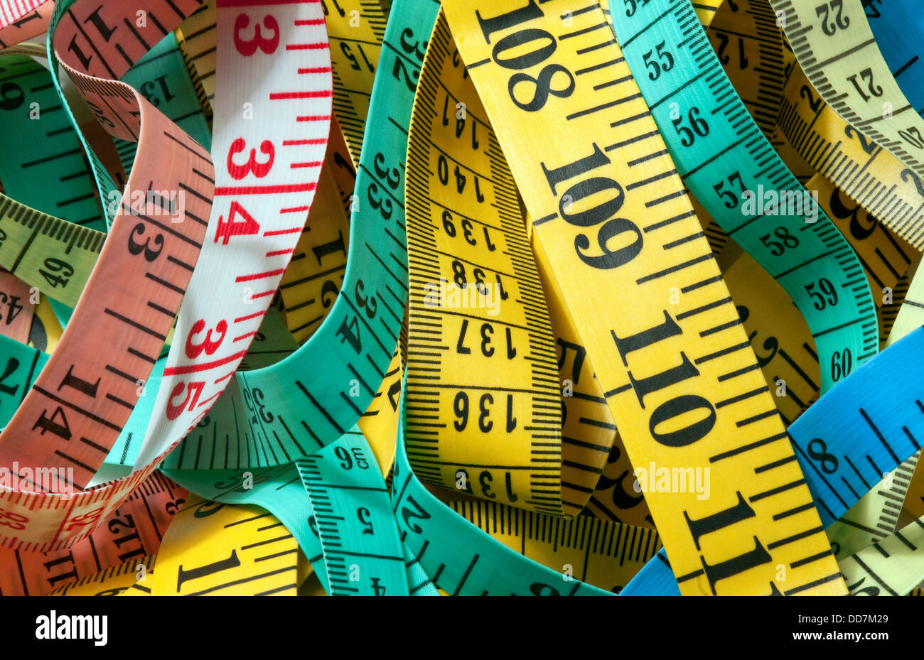 selection of colourful tape measures - Stock Image