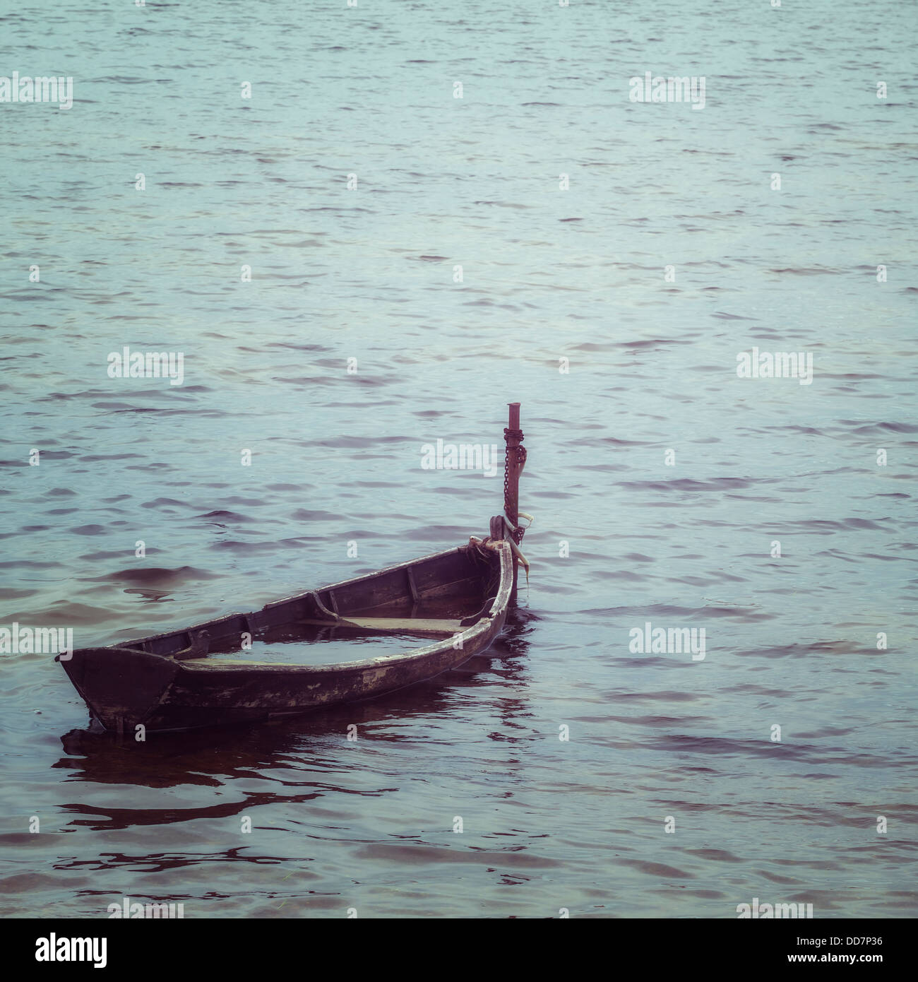 and old, almost sunken wooden boat - Stock Image