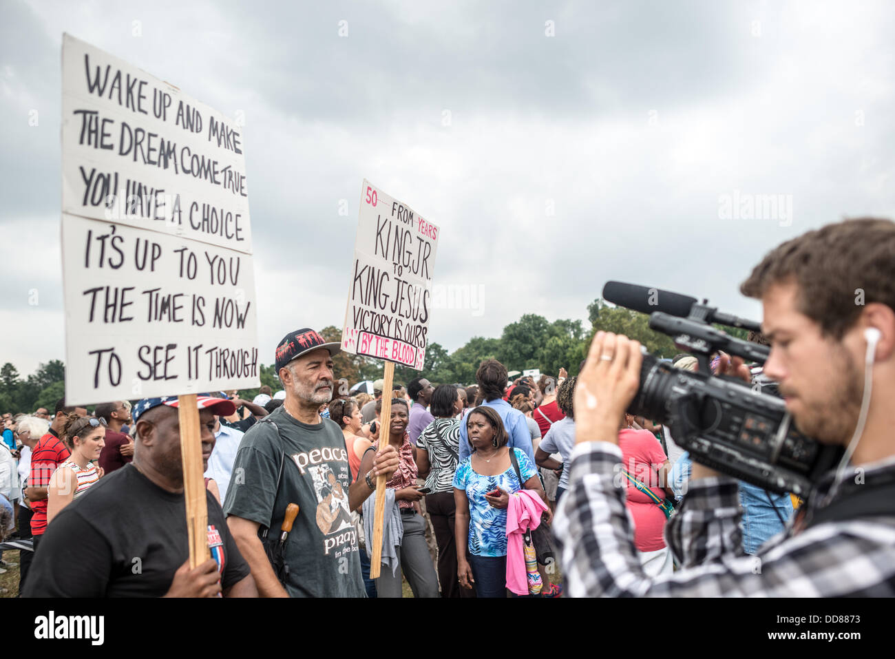 WASHINGTON DC, USA (Oct. 28, 2013) - Two men carrying placards calling on the legacy of Martin Luther King Jr's - Stock Image