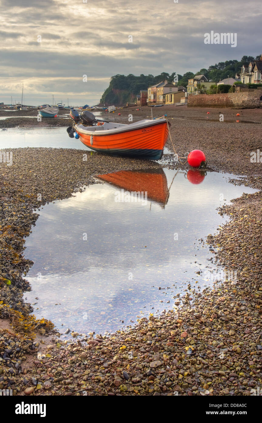 The vibrantly painted fishing boat 'Dixie',  in the  early morning light, on the shingle beds of the 'The Salty', Stock Photo