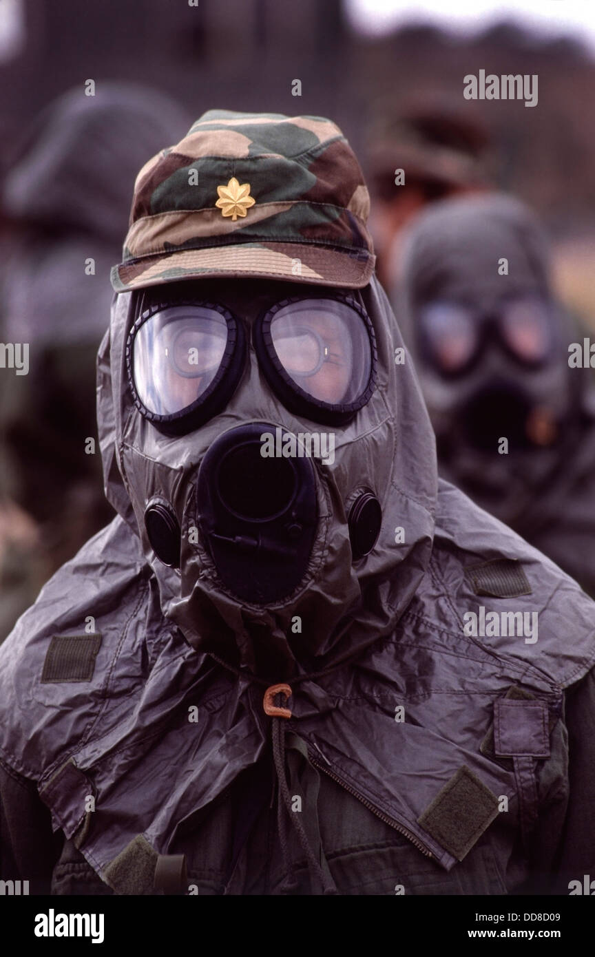 Doctors in the 347th Army Medical Reserve unit wearing gas masks and protective clothing during chemical weapons - Stock Image