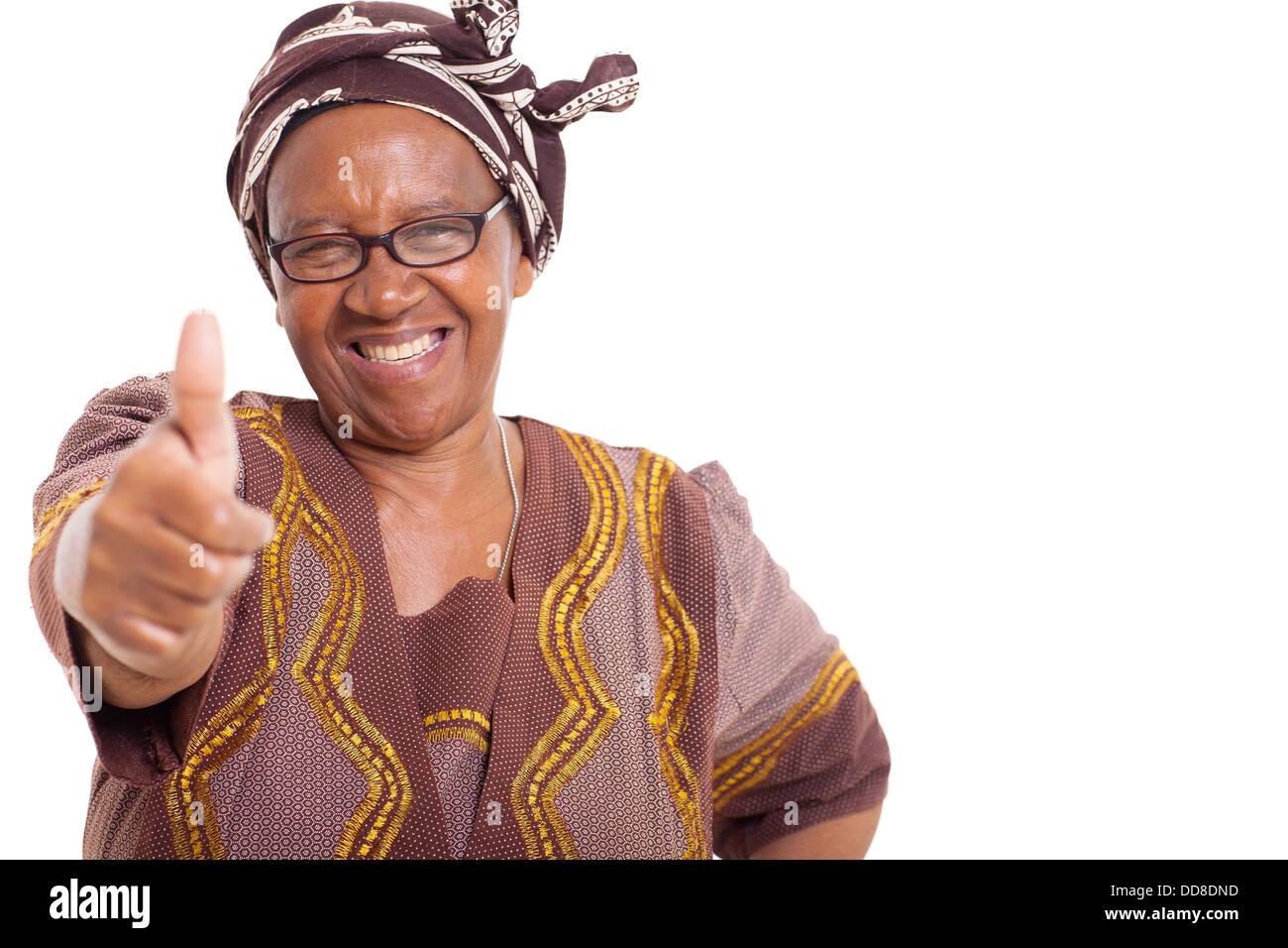 mature African woman with happy smile giving thumbs up on white background - Stock Image