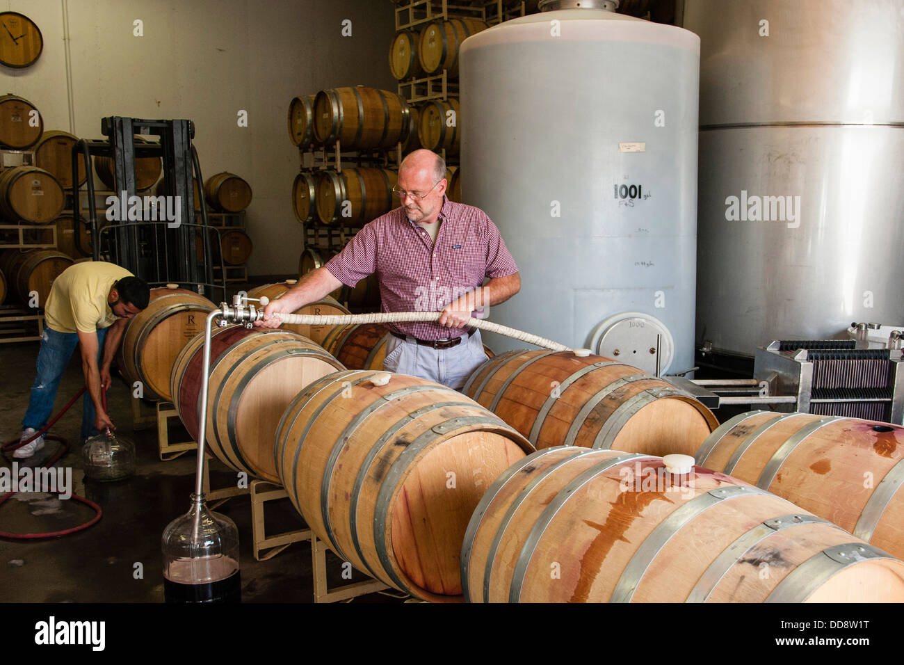 John Zimmerman winemaker for Tefft Cellars uses a topping wand to fill a wine barrel. & USA Washington Outlook. John Zimmerman winemaker for Tefft ...