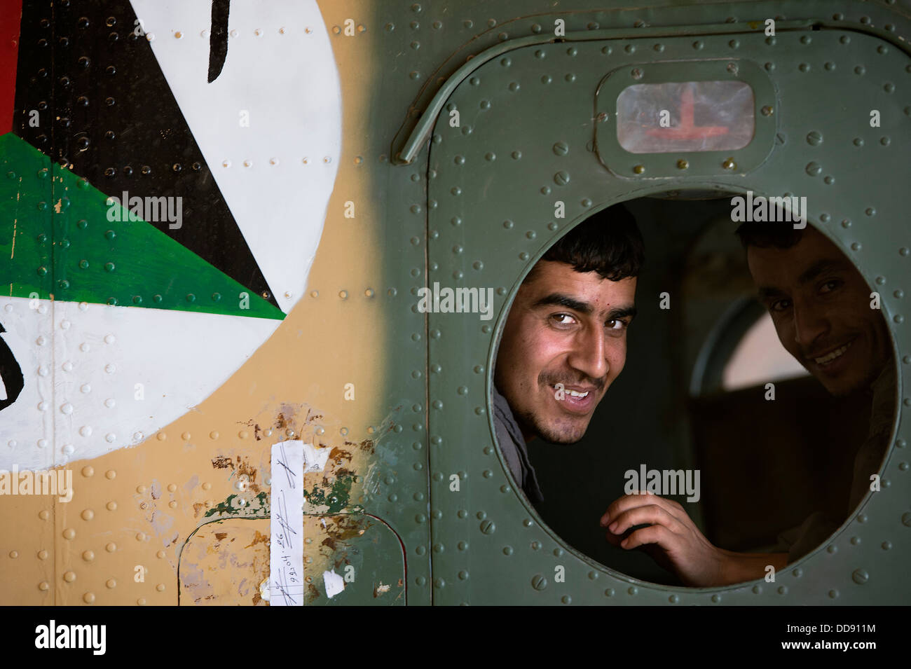 Afghan air force Sgt. Naqeebullah, Kabul Air Wing engine mechanic, peers through an Mi-17 helicopter window in a - Stock Image