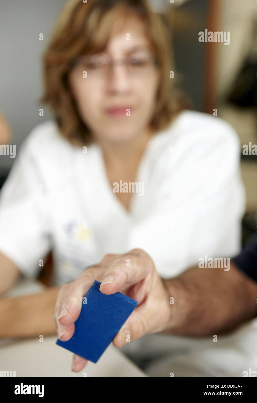 Occupational therapy, geometric forms: shape and texture recognition exercise, exteroception. Hospital Universitario - Stock Image