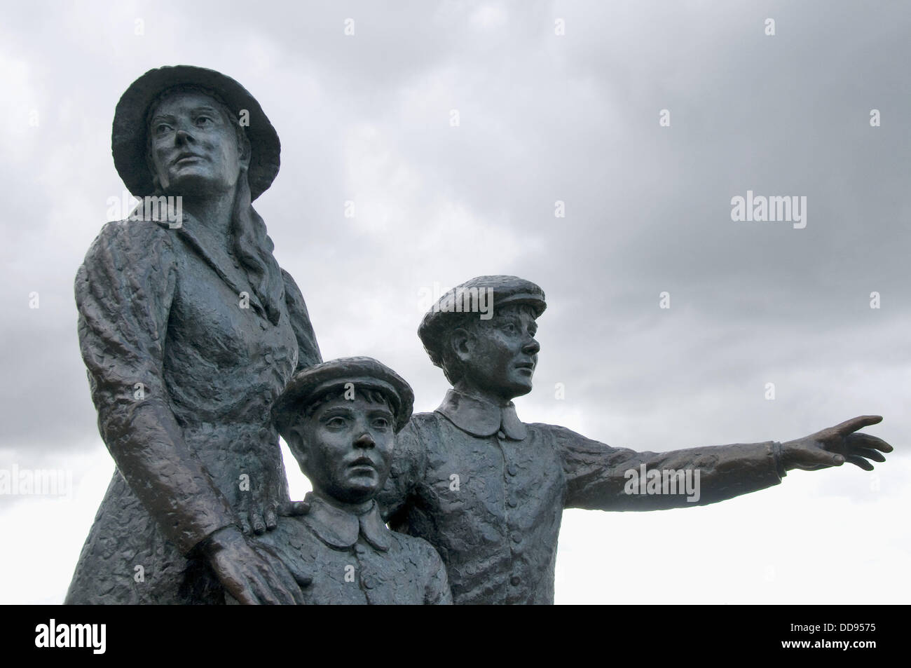 Statue of fifteen - year - old Annie Moore and her two younger brothers who left Queenstown (Cobh) on December 20th, - Stock Image