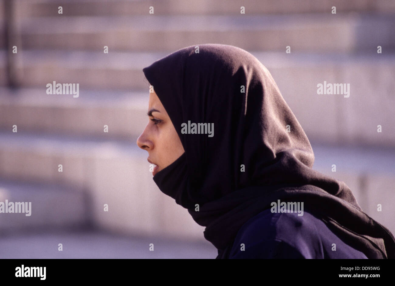 A young woman wearing a Chador headdress in the old city East Jerusalem Israel - Stock Image