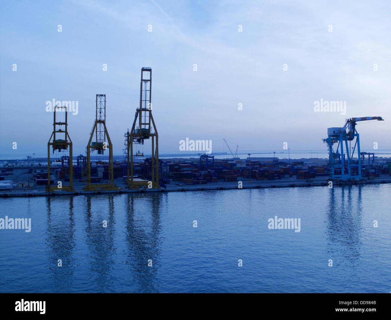 Blue hour, lift cranes in the port of Valencia, Spain - Stock Image