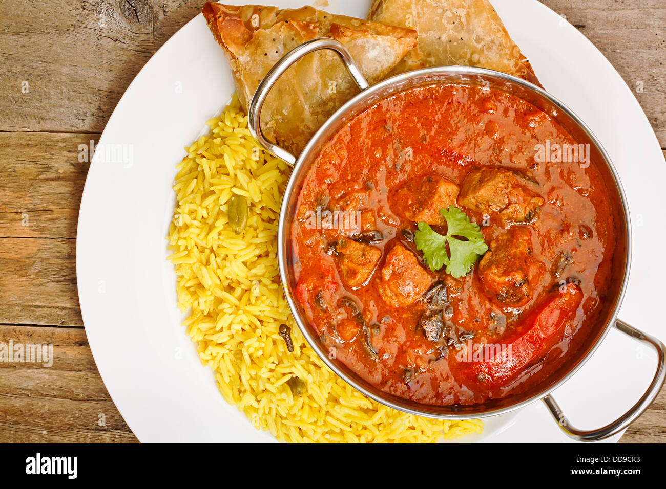 Beef Rogan Josh a popular indian curry with red pepper and spinach top view - Stock Image
