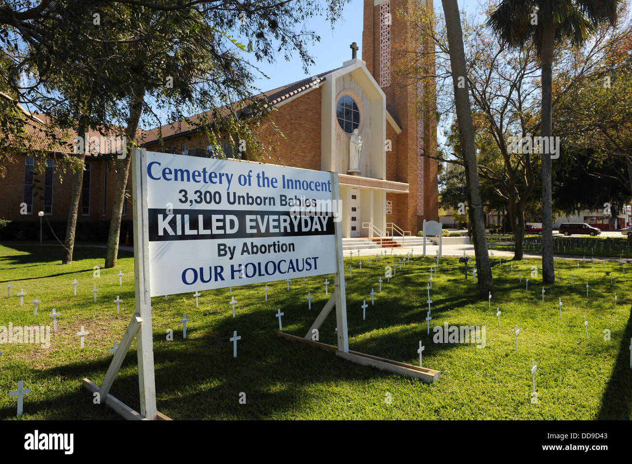 Crosses and sign on church lawn represent abortions performed Stock Photo