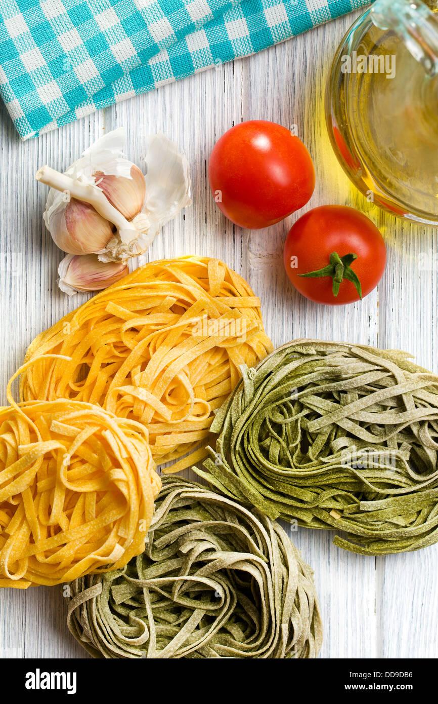 Italian pasta tagliatelle on kitchen table - Stock Image