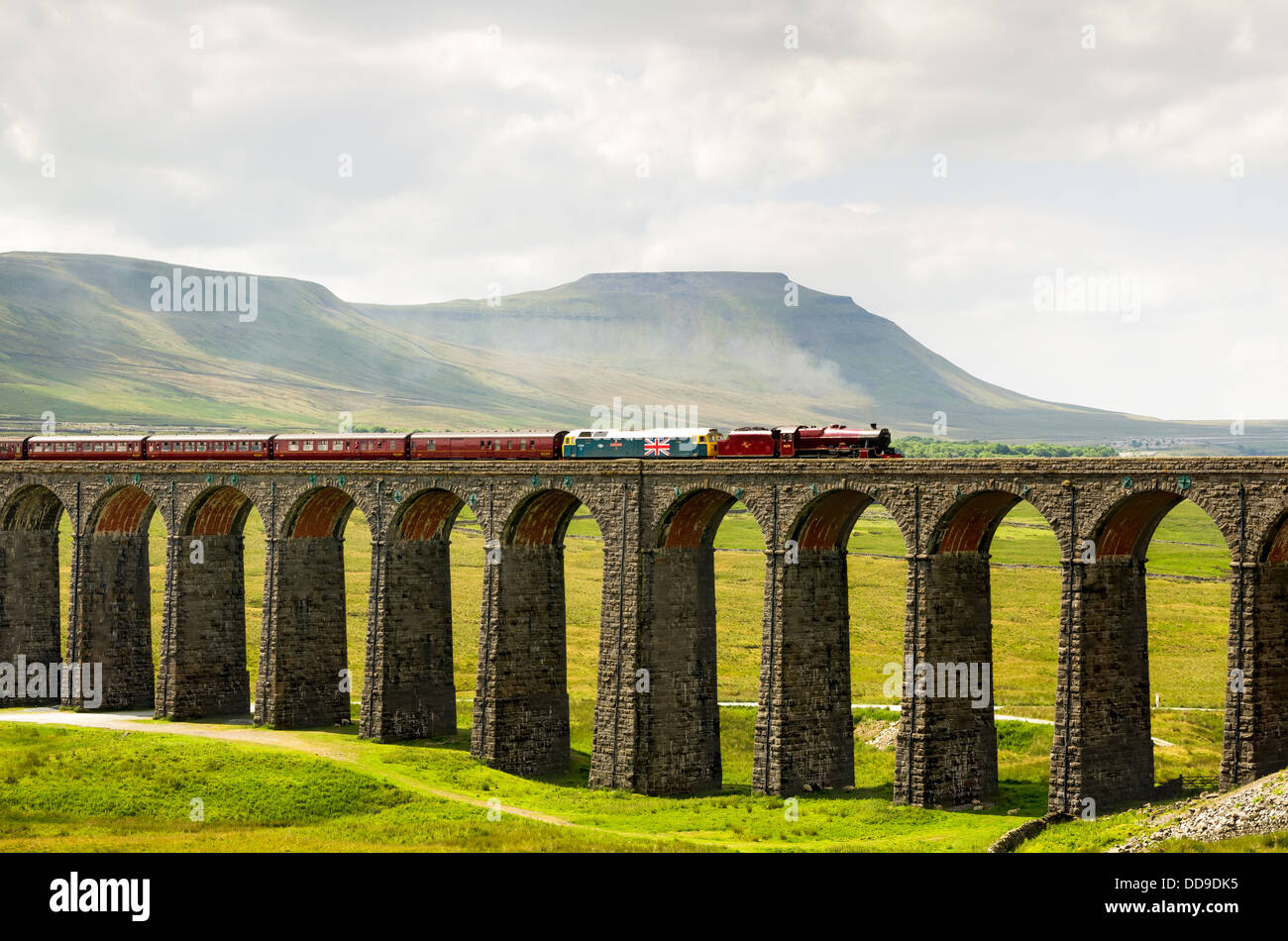 Steam engine 'Galatea' on the Ribblehead viaduct in the Yorkshire Dales with Ingleborough beyond. - Stock Image